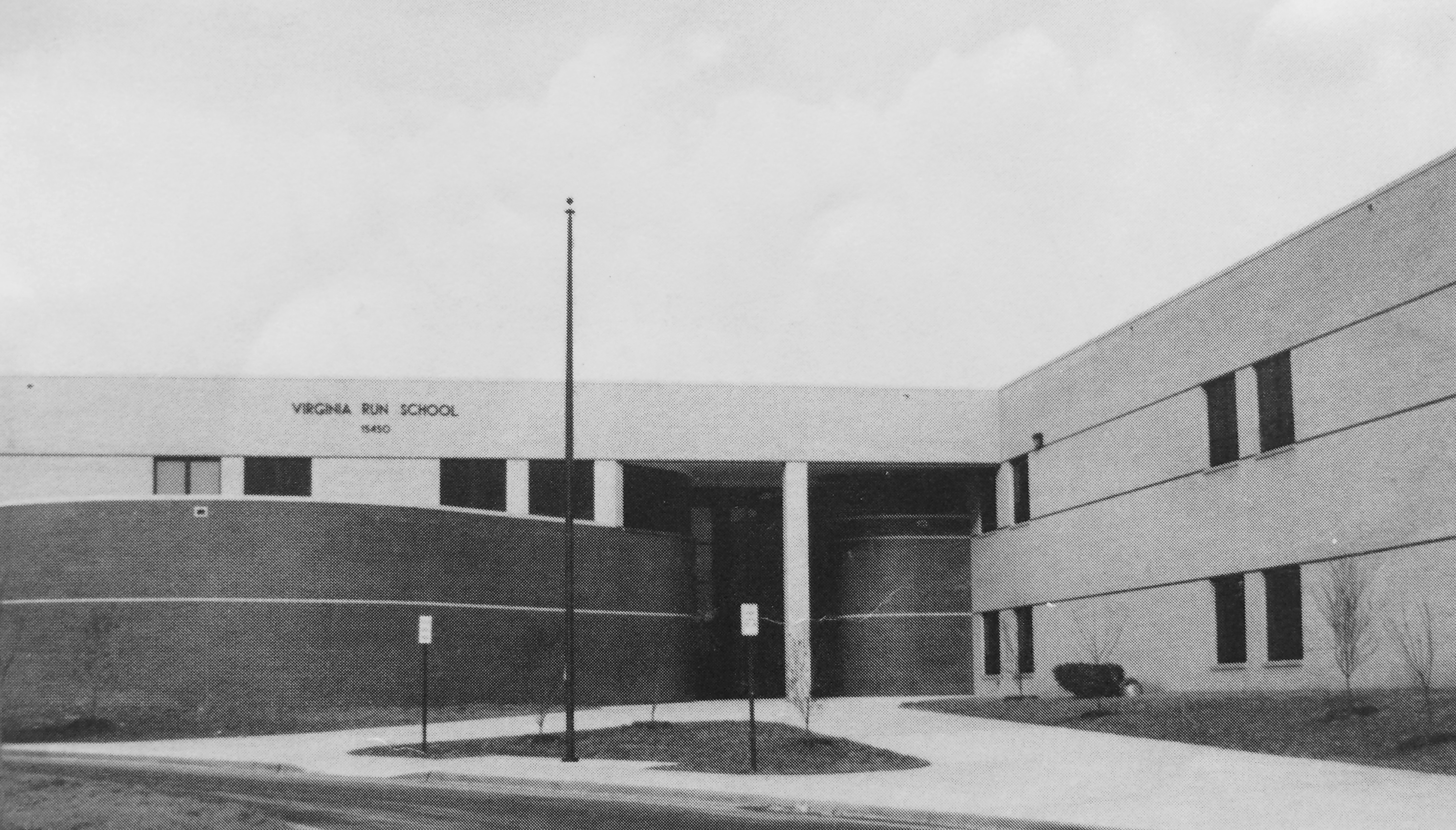 Black and white photograph of Virginia Run Elementary School, taken from our 1989-1990 yearbook. The photograph shows the main entrance to the building. The trees out front have been freshly planted and are not yet in leaf.